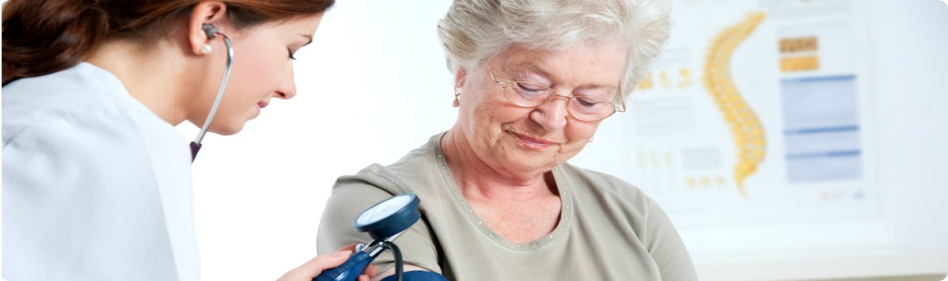 caregiver taking patient's blood pressure