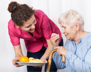 caregiver assisting patient on reading
